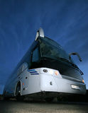 Details of passenger bus. Exterior details of passenger bus seen at twilight from low position, blue sky background Royalty Free Stock Photos