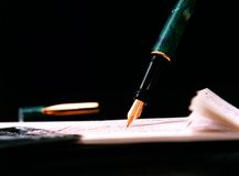 Details of pen writing cheque Stock Photography