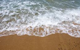Details of pictorial wave and fine sand on a beach Royalty Free Stock Photos