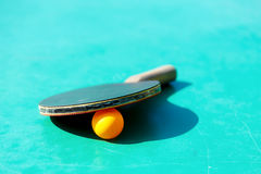 Details of pingpong table with playing equipment and yellow ball. Details of pingpong table with playing equipment and yellow ball Royalty Free Stock Photos