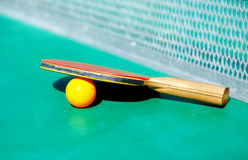 Details of pingpong table with playing equipment and yellow ball. Details of pingpong table with playing equipment and yellow ball Stock Image