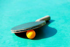 Details of pingpong table with playing equipment and yellow ball. Details of pingpong table with playing equipment and yellow ball Royalty Free Stock Photo