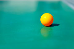 Details of pingpong table with playing equipment and yellow ball. Details of pingpong table with playing equipment and yellow ball Royalty Free Stock Image