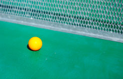 Details of pingpong table with playing equipment and yellow ball. Details of pingpong table with playing equipment and yellow ball Stock Images