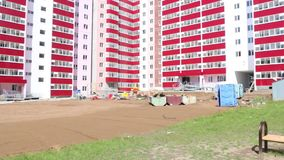 Details of playground, sand near building under construction. PERM, RUSSIA - JUL 13, 2016: Details of playground, sand near building under construction of PZSP stock video footage