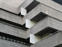 Details of railings and balconies on an old brutalist concrete building. Details of railings and balconies on an old brutalist grey concrete building Royalty Free Stock Photos