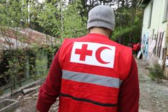 Details with the Red Cross and Red Crescent symbol on a uniform. royalty free stock photography