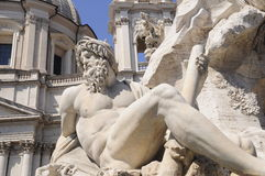 Details of Roman statue. Details of a reclining man on a Roman statue Stock Photography