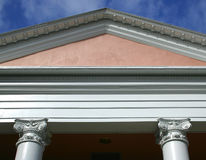 Details of roof. Details of Mediterranean building, showing columns and lintel, against dark blue sky stock photos