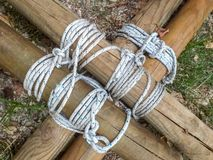 Details of round section beams linked together with ropes. often used by boy scouts for the construction of camp objects. Details of round section beams linked royalty free stock photography