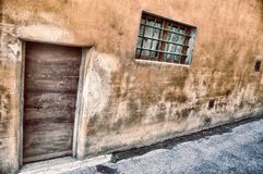 Details of a rural house wall. In Firenze, Tuscany, Italy Royalty Free Stock Image