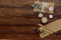 Details of a rustic wedding over wooden background. Flat Lay, Top View,. Copy Space Stock Image