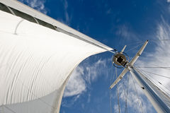 Details of sail and mast. Details of sail billowing in wind, seen looking up to top of mast Royalty Free Stock Photo