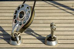 Details of sailboat. A sailboat steel pulley with rope Royalty Free Stock Photos