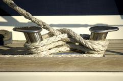 Details of sailboat. A sailboat steel pulley with rope Stock Photos