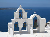 Details of Santorini island Greece - beautiful typical church wi. Th white belfry and blue sea Royalty Free Stock Photo