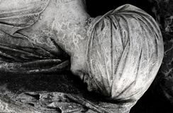 Details sculpture head women. On grave monument royalty free stock photo