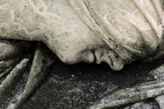 Details sculpture head women. On grave monument stock images