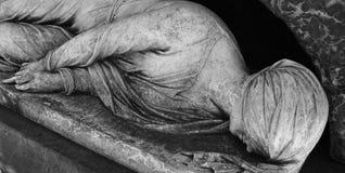Details sculpture head women. On grave monument stock photography