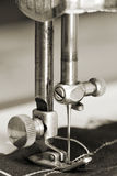 Details of sewing-machine. A closeup photo of a needle of a sewing machine Royalty Free Stock Photography