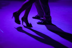 Details of shoes of tango dancers. Tango dancers in milonga ballroom, detail of shoes Stock Image