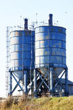 The details of silos, containers for grain with pigeons. On top of that to rest royalty free stock image
