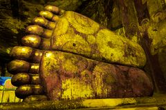 The feet of reclining Buddha statute in cave temple complex of Sri Lanka. Details of the sole of reclining Buddha statute at Dambulla Cave Temple, the cave Stock Images