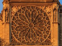 Details of the southern facade of Notre Dame de Paris Cathedral facade with the rose window and ornate tracery in the warm light. Details of the southern facade stock photos