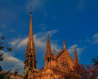 Details of the southern facade of Notre Dame de Paris Cathedral facade with the rose window and ornate spires in the warm light of. Details of the southern royalty free stock photo