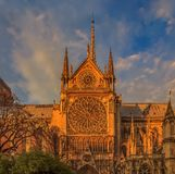 Details of the southern facade of Notre Dame de Paris Cathedral facade with the rose window and ornate spires in the warm light of. Details of the southern royalty free stock photos