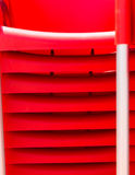 Details of stack red chairs from hard plasti Stock Images