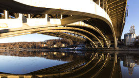 Details of steel bridge and reflection in water. Of moscow river Royalty Free Stock Photography