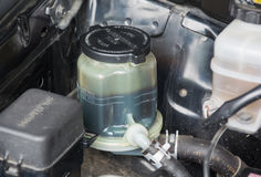Details of a steering fluid reservoir Stock Photography