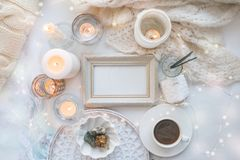 Details of still life in the home interior. Aroma stick, interior items, candles, frame for text, Moody. Cosy autumn winter light. Concept. Copy space stock photos