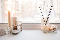 Details of still life in the home interior. Aroma stick, interior items, candles, Moody. Cosy autumn winter light concept. Copy. Space, monochrome background royalty free stock photography