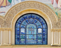 Details of stone carving and stained glass window Royalty Free Stock Photos