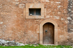 Details of a stone wall with window and door Stock Images