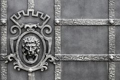 Details, structure and ornaments of forged iron gate. Decorative. Ornamen with lions , made from metal. Vintage metallic pattern. Decorative elements as a Stock Photo