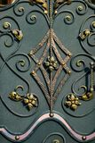 Details, structure and ornaments of forged iron gate. Floral dec Stock Images