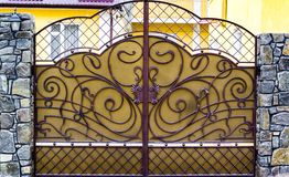details of structure and ornaments of wrought iron fence and gate Stock Photo