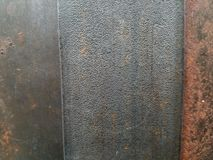 Metal surface texture with three vertical panels in closeup royalty free stock image