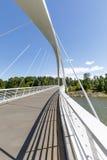 Details of suspension bridge across water. Details of white suspension bridge over water in summer Stock Image
