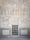 Details of Taj Mahal architecture at the entrance on white marble background Stock Photo