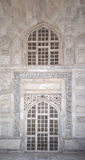 Details of Taj Mahal architecture at the entrance on white marble background Royalty Free Stock Images