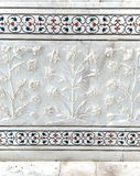 Details of Taj Mahal architecture on white marble background Royalty Free Stock Photo