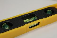 Interesting detail - spirit level on white background. Details of technology - spirit level with bubbles of air in liquid, white background Stock Photos