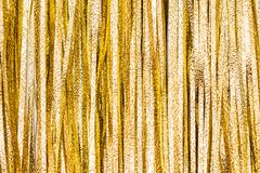 Details and texture from golden tinsel strips Royalty Free Stock Photo