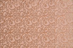 Beige colored patterned fabric texture. Details of the texture and weaving of beige fabric royalty free stock photography