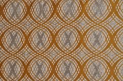 Beige colored patterned fabric texture. Details of the texture and weaving of beige fabric royalty free stock image