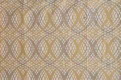 Beige colored patterned fabric texture. Details of the texture and weaving of beige fabric stock images